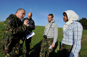 Flight Lieutenant (then Flying Officer) Tony Newton working with 'journalists' and 'humanitarian workers' on Exercise Chiltern Kite on Salisbury Plain earlier this year