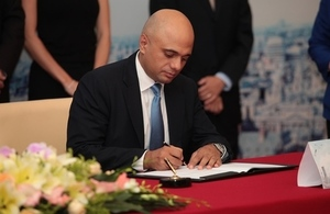 Sajid Javid signing a partnership agreement with Shanghai Cross-Border E-Commerce Public Platform