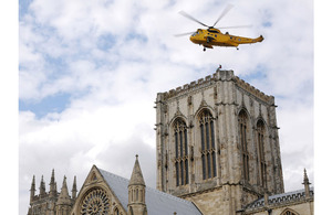 A Leconfield Search and Rescue Sea King helicopter from E Flight, 202 Squadron, taking part in a simulated casualty evacuation from the top of York Minster