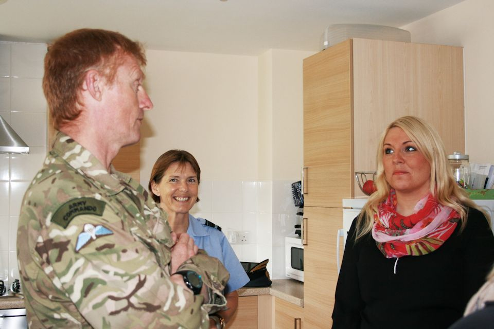 Major General Alastair Dickinson and Air Vice-Marshal Elaine West visit one of the new Service family homes opposite the barracks. Photo credit - Rhian Edwards, Crown Copyright MOD 2015