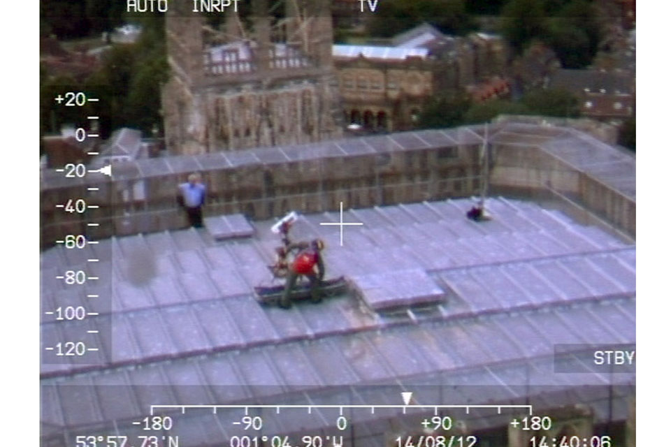 The view from the cockpit of a Leconfield Sea King Search and Rescue helicopter as a crewman simulates a casualty evacuation from the top of York Minster