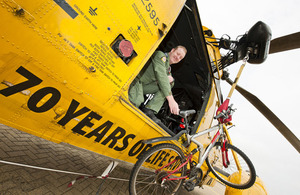 RAF Search and Rescue crewman Sergeant Lee Clark with two of his favoured modes of transport