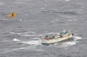 The Sea King helicopter approaches the fishing vessel at the start of the operation to airlift the critically-ill member of the crew