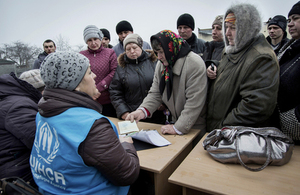 UNHCR staff distribute aid to people affected by conflict in Ukraine, March 2015. Picture: Andrew McConnell/Panos