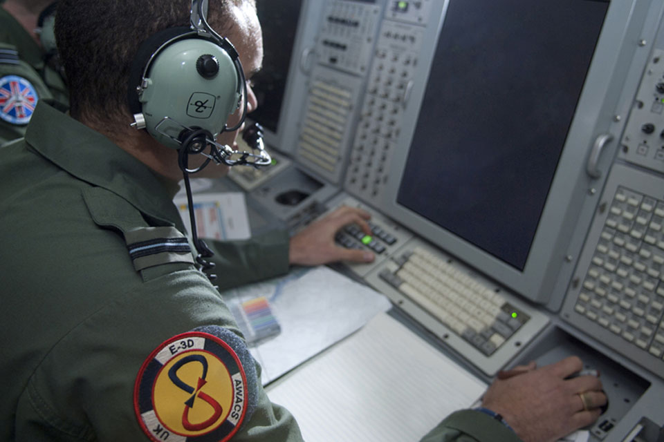 Crew members onboard an RAF E-3D Sentry aircraft (stock image)