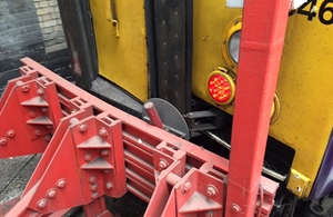 Image showing damage to train and buffer stops at Kings Cross station