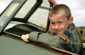 Seven-year-old Charlie Parrott sits in the cockpit of a replica Hurricane at RIAT 2010