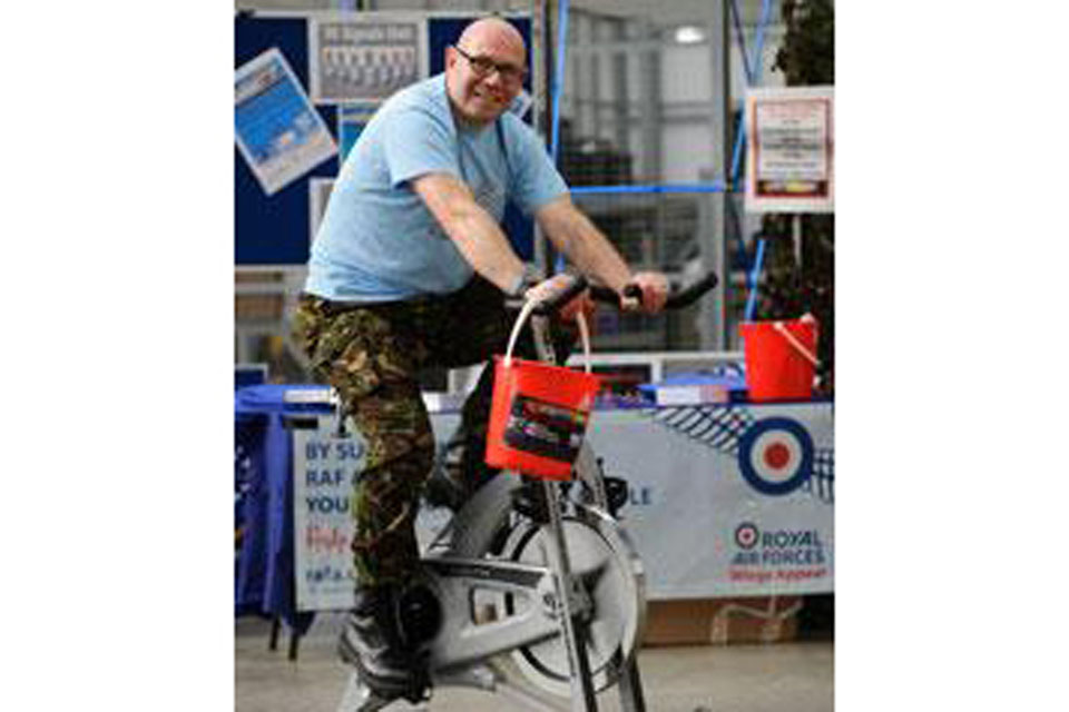 An airman clocks up miles and money for charity at RAF Leeming