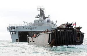 HMS Bulwark and one of her landing craft