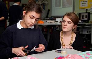 A girl and teacher in a textiles class.