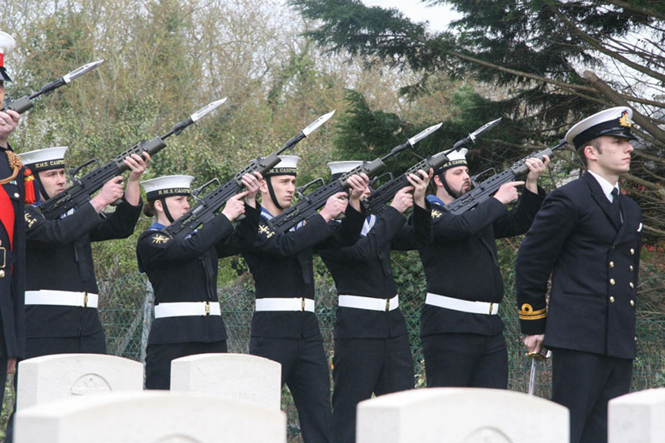 Members of HMS Campbeltown's ship's company conduct seven-gun salute at the cemetery in St Nazaire in remembrance of the fallen