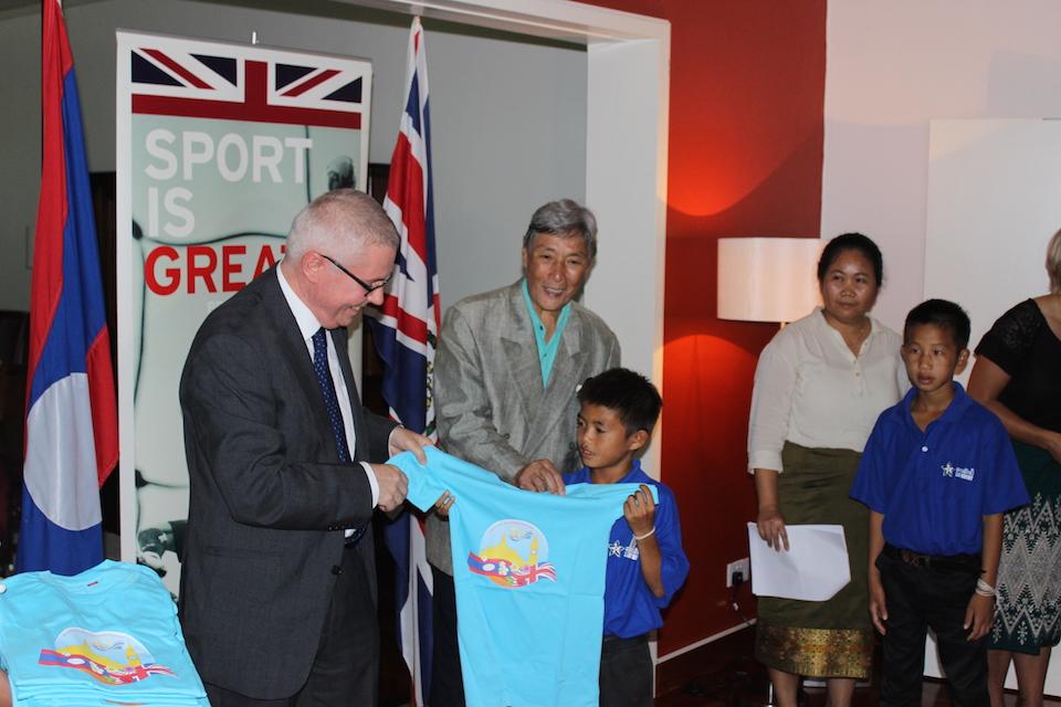Ambassador presenting T-Shirts