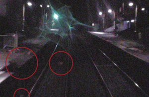 Displaced coping stones and debris on the track (circled) recorded by forward facing CCTV on the passenger train (image courtesy of Northern Rail)