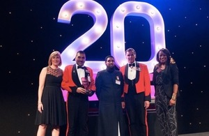 Members of the Armed Forces Muslim Association collecting their 'Race for Opportunity' Award