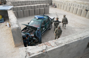 Royal Military Police passing on incident investigation skills to the Afghan Uniform Police