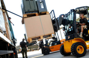 Members of the Defence Support Group unload supplies from lorries at Gioia del Colle in southern Italy