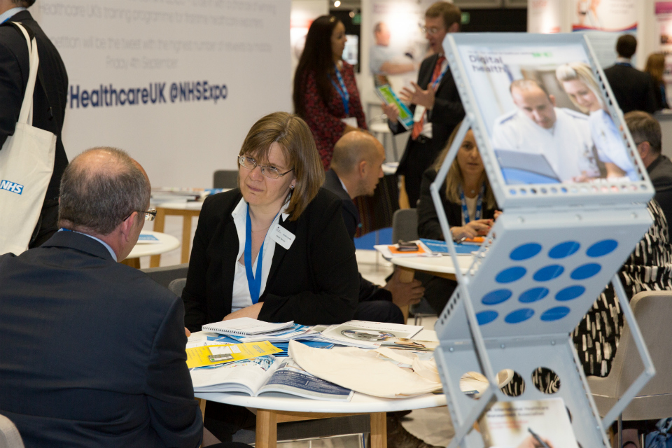 Discussions on the Healthcare UK stand at NHS Expo