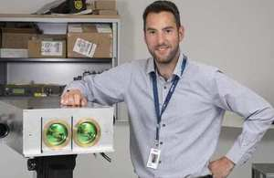 Yoann Thueux, project team leader, with laser beam communication equipment