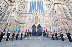 Standard Bearers line the steps leading into York Minster for the unveiling of a memorial to Second World War French airmen