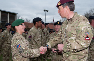Private receives her Afghanistan campaign medal from Major General James Bashall at a parade in Paderborn, Germany