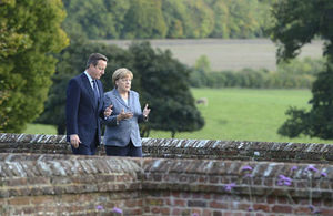 Prime Minister Cameron and Chancellor Merkl in a private meeting in the countryside