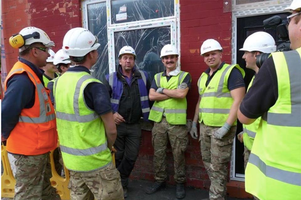 Members of the Corps of Royal Engineers with Nick Knowles