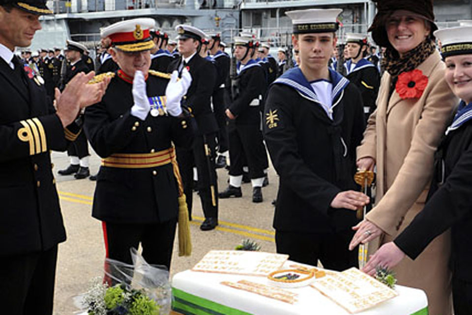 Able Seaman Jonathan Thorne, Lieutenant Commander Gillian Russell and Able Seaman Katie Hickman cut the traditional rededication cake