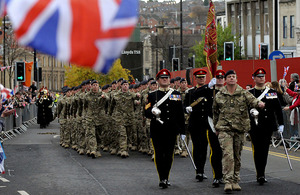 Members of the Light Dragoons march through Barnsley