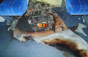 The damaged floor of the train