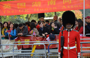A soldier from the Scots Guards stands on the procession route in front of spectators