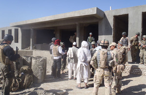 Afghans view progress of school building project