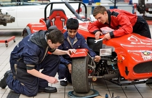 Apprentices working on a car