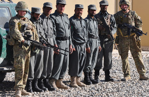 British soldiers pose with some of the Afghan policemen