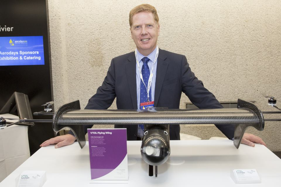 Ashley Bryant, managing director of VTOL Technologies, at his stand exhibiting a wing design at Aerodays 2015.