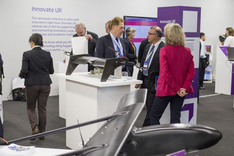 Innovate UK exhibition area at Aerodays 2015, with a UAV in the foreground.