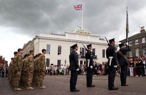 Personnel from II Squadron RAF Regiment stand to attention on Angel Hill, Bury St Edmunds