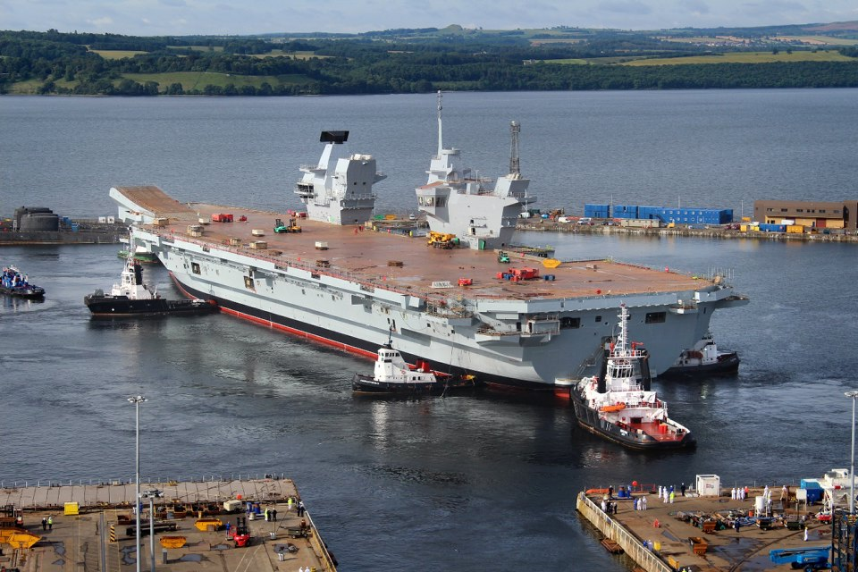 The Royal Navy's largest ever warship HMS Queen Elizabeth is gently floated out of her dock for the first time in Rosyth, Scotland in July 2014.