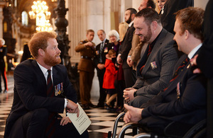 HRH Prince Harry talks to bomb disposal veterans at the commemorative service [Picture: Sgt Rupert Frere Crown Copyright]