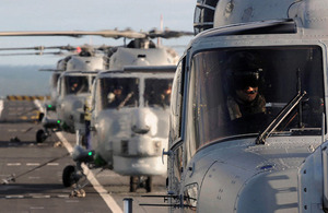702 Naval Air Squadron's Lynx Mk8 helicopters line the flight deck of HMS Illustrious