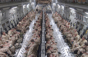Troops inside a C-17 Globemaster transport aircraft