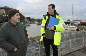 Environment Agency staff talking to a resident about flooding.