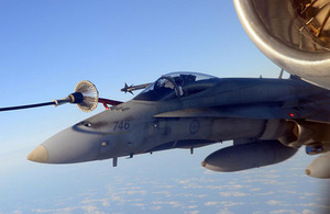 A Canadian F-18 aircraft refuels from a VC10 K3 of 101 Squadron RAF during a mission as part of the NATO-led Operation UNIFIED PROTECTOR