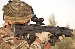 Highlander Mark Mackenzie, 4 SCOTS, checks his sector while patrolling in Lashkar Gah District, Helmand province
