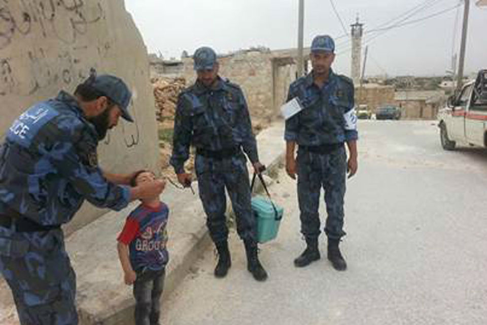 Members of the Free Syria Police taking part in the Assistance Coordination Unit's polio vaccination campaign