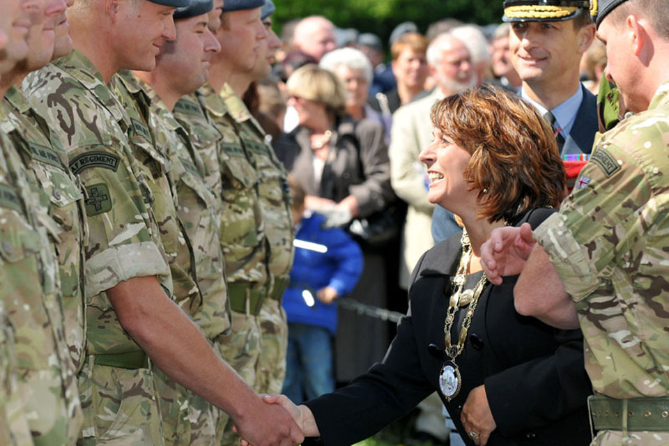 Councillor Mrs Amanda Coates, Mayor of Bedale, greets a Gunner from 34 Squadron RAF Regiment as she hands out Afghanistan campaign medals