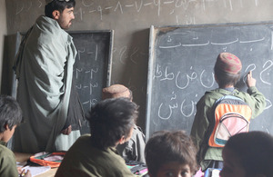A teacher conducting a lesson at Rahim Kalay's new school