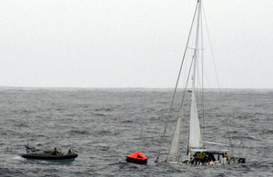 A rigid inflatable boat from HMS Clyde approaches the stricken yacht