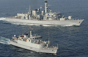 HMS Iron Duke (top) and HMS Grimsby in the Gulf