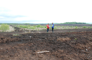 Two people standing on the peatlands at Bolton Fell and Walton Mosses Site of Special Scientific Interest in north Cumbria