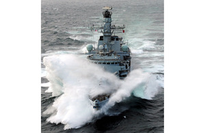 HMS Iron Duke pictured in rough weather in the Indian Ocean